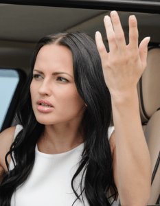 Photo of a woman angry and throwing her hands in the air