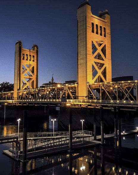 Photo of the Tower Bridge in Sacramento at night.